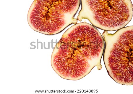 Slices of fresh figs on white - abstract background. - stock photo