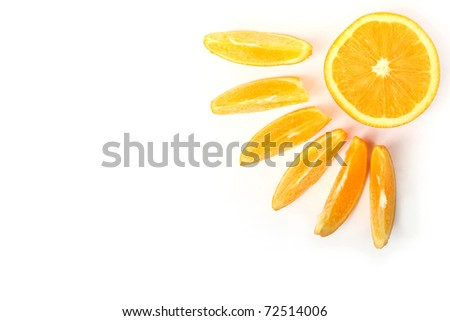 Slices of fresh orange representing sun with beams isolated on white - stock photo