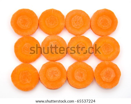 Slices of fresh organic carrot over white background