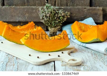 Slices of fresh pumpkin, selective focus. - stock photo
