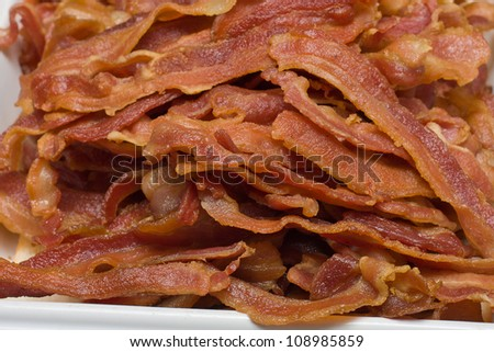 Slices of fried bacon - stock photo