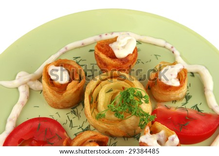 slices of fried potatoes with vegetables - stock photo
