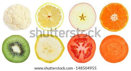 Slices of fruit and vegetables isolated on white - stock photo