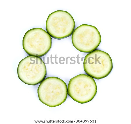 slices of green zucchini isolated on white - stock photo