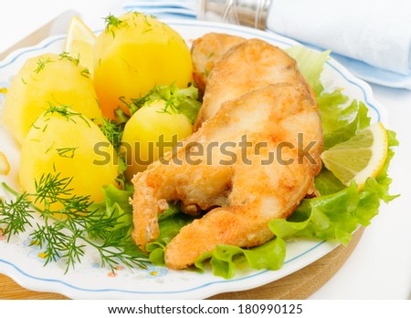 Slices of grilled sea bass with boiled potatoes.