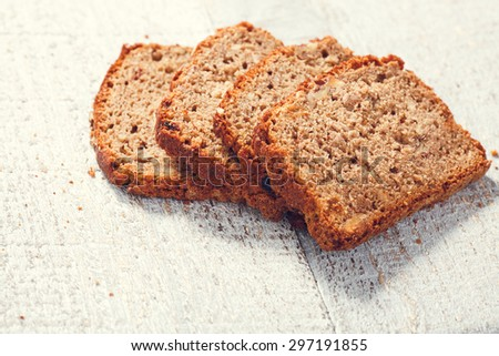 Slices of homemade whole grain bread on the boards, closeup - stock photo