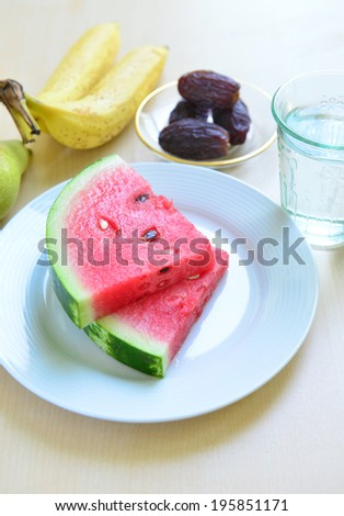 Slices of juicy watermelon with other fruits - a Ramadan food - stock photo