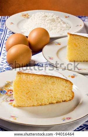 Slices of lemon cake, eggs and flour.... - stock photo