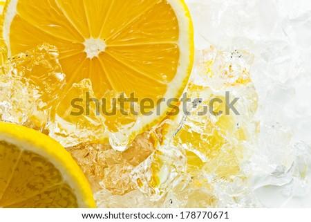 slices of lemon with ice - stock photo