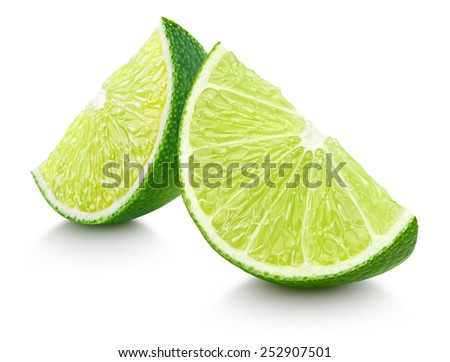 Slices of lime citrus fruit isolated on white with clipping path - stock photo