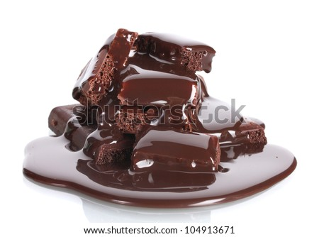 Slices of milk and dark chocolate bar poured chocolate isolated on white - stock photo