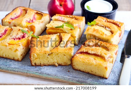 Slices of nectarine polenta cake - stock photo