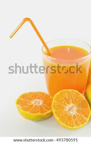 Slices of orange with orange juice fresh in glass isolated on white background.