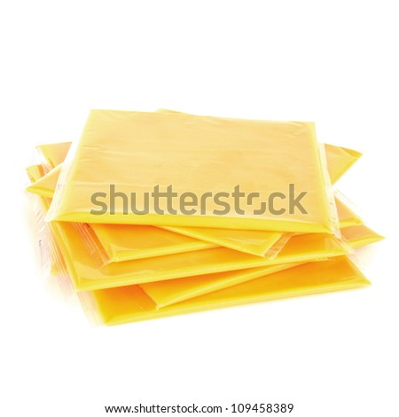 Slices of processed American cheese on white background - stock photo