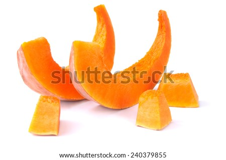 Slices of pumpkin isolated on white background - stock photo
