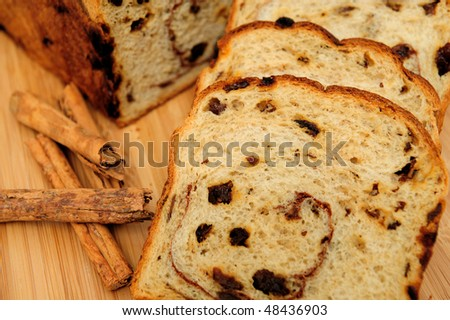 Slices of raisin cinnamon bread with slices laid out showing the detail in the slice including the raisins