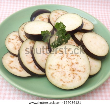 Slices of raw eggplants