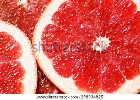 Slices of red grapefruit, top view, selective focus