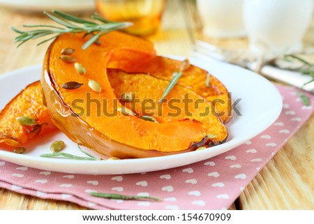 slices of roast pumpkin on a plate, food close up - stock photo
