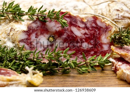 Slices of Salame from Italy on Wooden table - stock photo