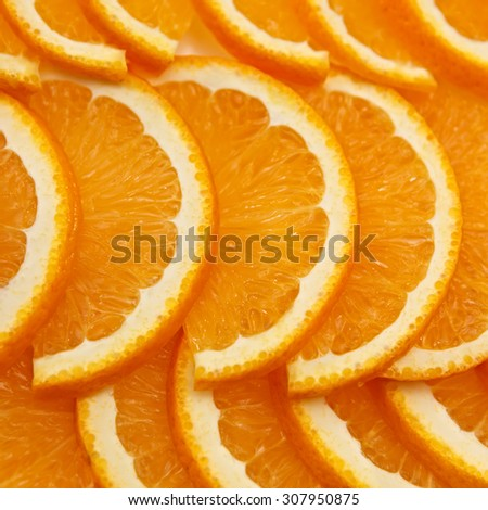 Slices of sliced ripe orange - stock photo