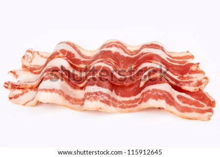 Slices of smoked bacon close up - stock photo
