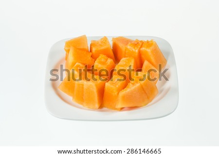 Slices of succulent Orange melon lie on a plate - stock photo