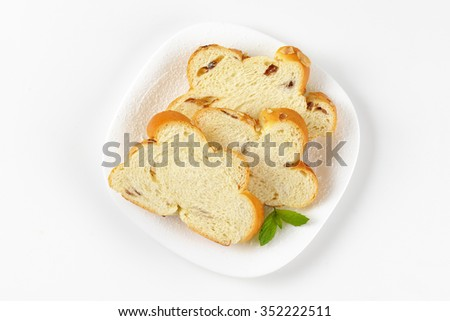 slices of sweet braided bread on white plate