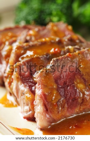 Slices of tender beef served with peanut sauce - stock photo