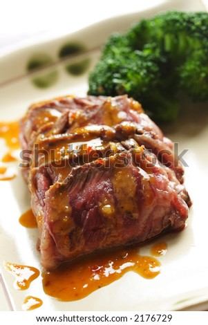 Slices of tender beef served with peanut sauce and vegetables