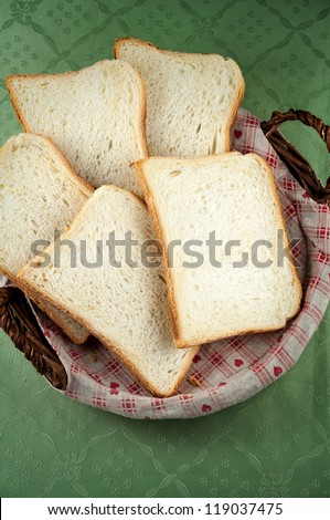 Slices of toast bread on a basket - stock photo