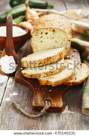 Slices of vegetable bread with zucchini and onions