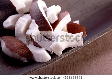 slices of white and brown tropical coconut fruit - stock photo