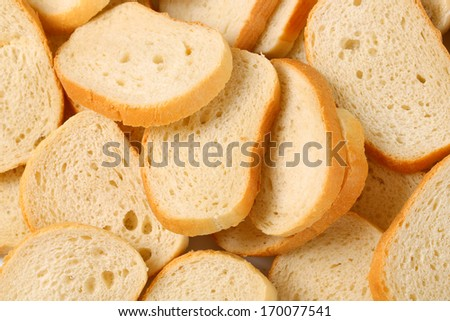 Slices of white bread on white background - stock photo