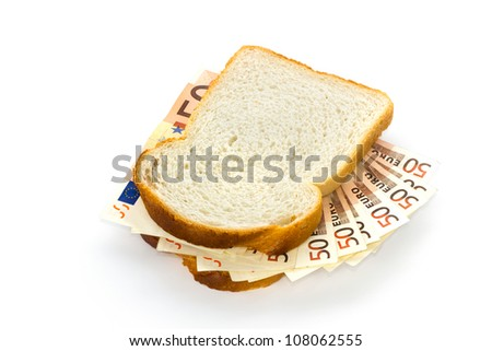 Slices of white bread with 50 euro bills sandwich filling - stock photo