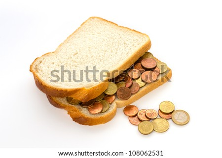 Slices of white bread with euro coins spread and some spilling