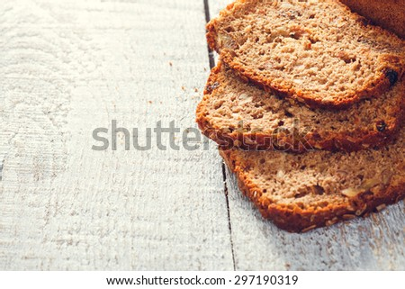 Slices of whole grain bread on the boards, closeup - stock photo
