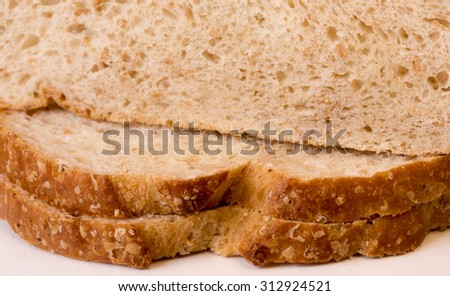 Slices of wholewheat sourdough bread - stock photo
