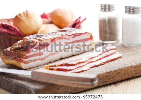 slices smoked bacon on kitchen table