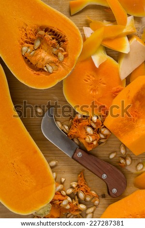 Slicing pumpkins for soup - stock photo