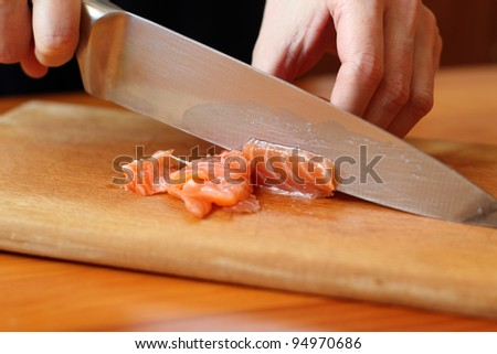 Slicing Salmon - stock photo