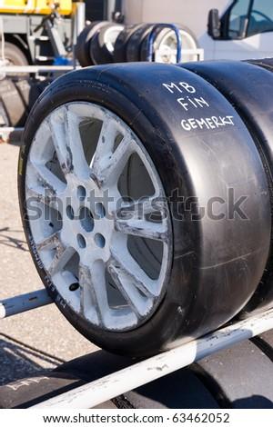 Slick tyre on rack, marked - stock photo