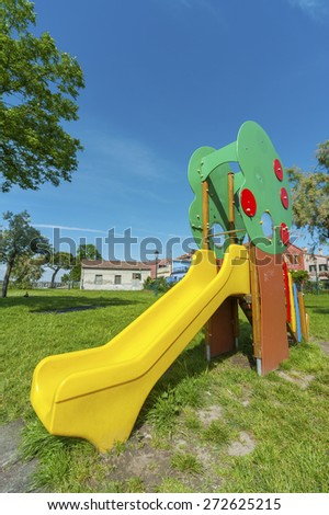 slide in children playground in the park - stock photo