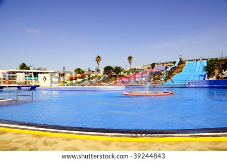 Slide in swimming pool. Children's game - stock photo