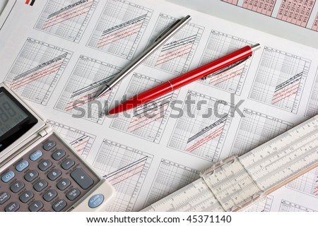 slide rule and drawing with graphics - stock photo