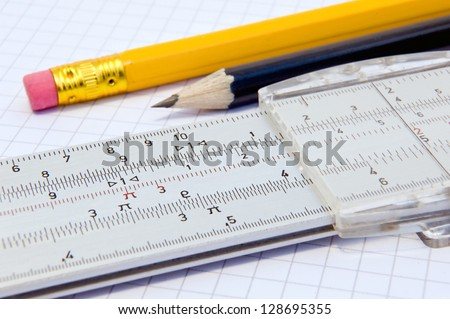 Slide rule and pencils - stock photo