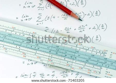 slide rule being used for calculation - stock photo