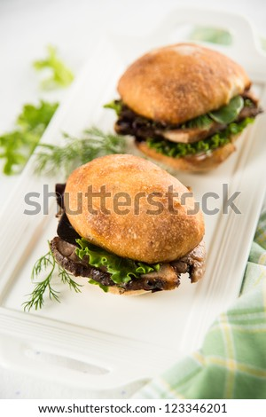Slider Sandwiches with Pulled Pork and Greens - stock photo