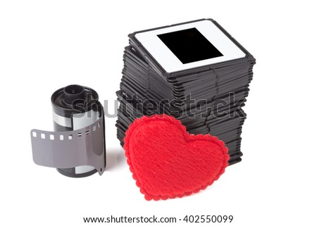 slides, film cartridge over white background with heart - stock photo