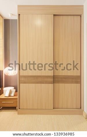 sliding doors wardrobe furnishing in small room. - stock photo
